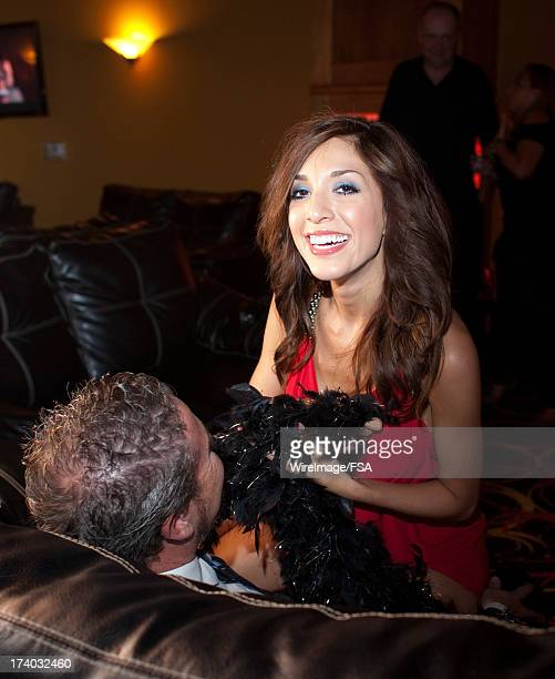Farrah Abraham gives a lap dance to Jonathan York while making an appearance at the new Vivid Gentlemen's Club on July 18 2013 in Mooresville North...
