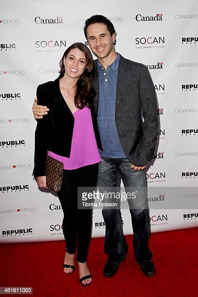 Farrah Azizi and John Tishbi attend the Canada Day party in LA on the Sunset Strip on July 1 2014 in West Hollywood California