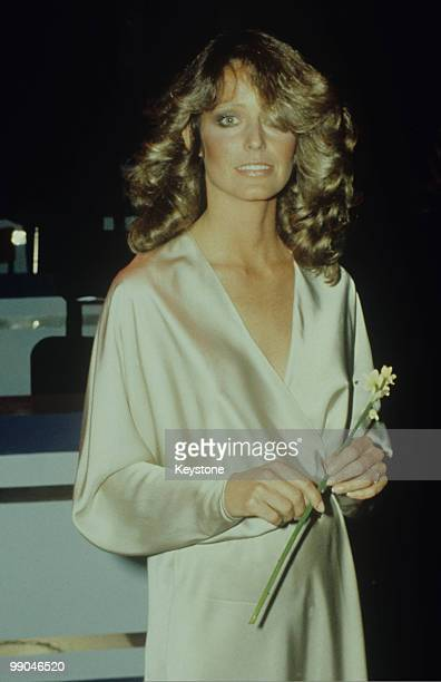 Farrah Fawcett actress pictured holding a flower at the London Palladium London Great Britain circa 1985