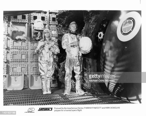 Farrah Fawcett and Kirk Douglas prepare for hurried spaceflight in a scene from the film 'Saturn 3' 1980 Photo by Associated Film Distribution /Getty...
