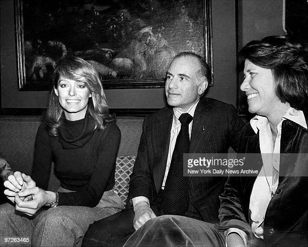 Farrah Fawcett and Liz Smith celebrate Farrah's birthday with unidentified man in the middle