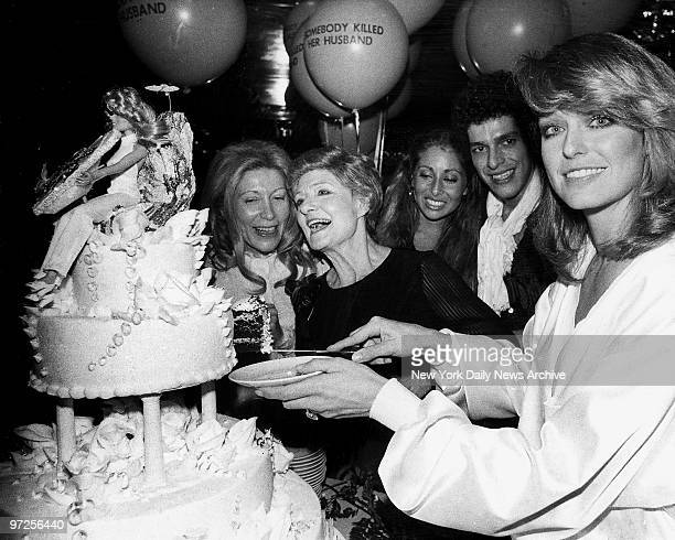 Farrah Fawcett cutting her birthday cat at New York New York Her mother Polly is in the center