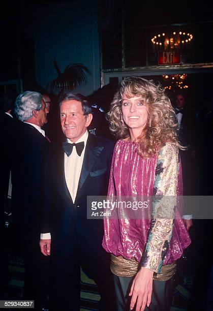 Farrah Fawcett in a pink lame blouse at a formal event circa 1970 New York