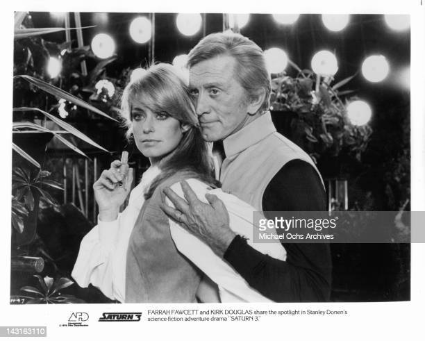 Farrah Fawcett is held by Kirk Douglas in a scene from the film 'Saturn 3' 1980 Photo by Associated Film Distribution /Getty Images