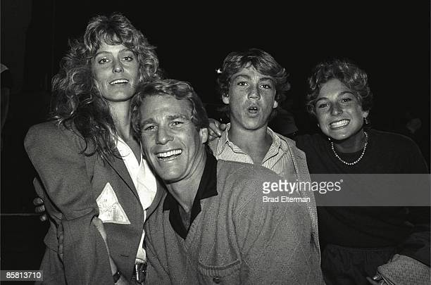 LOS ANGELES JANUARY 01 1980 Farrah Fawcett Ryan O'Neil Griffin ONeal and Tatum O'Neal backstage at a Rolling Stones concert circa 1980 in Los Angeles...