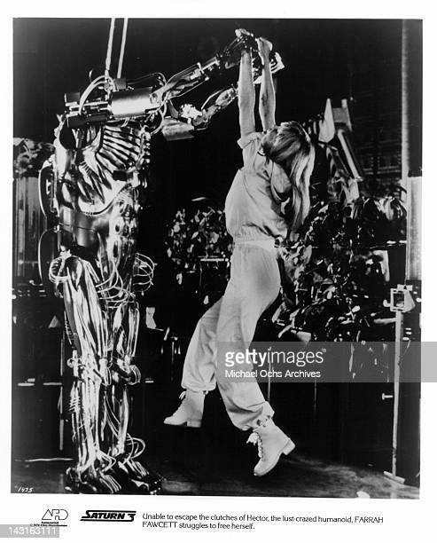 Farrah Fawcett tries to free herself from lustcrazed humanoid in a scene from the film 'Saturn 3' 1980 Photo by Associated Film Distribution /Getty...