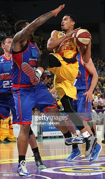 Farrakhan Mustapha of the Tigers drives at the basket under pressure from the 36ers defence during the round 18 NBL match between the Melbourne...