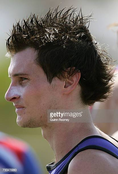 Farren Ray of the Bulldogs listens to the coach at quarter time during the Western Bulldogs intraclub AFL match at Whitten Oval on February 16 2007...