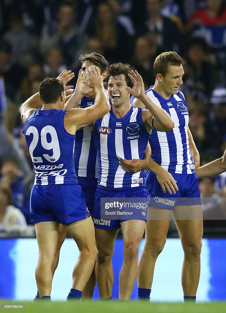 Farren Ray of the Kangaroos is congratulated by his teammates after kicking a goal during the round nine AFL match between the North Melbourne Kangaroos and the Carlton Blues at Etihad Stadium on May 21, 2016 in Melbourne, Australia.