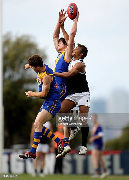 Farren Ray of Williamstown fails to hold the ball as his opponent Cruize Garlett of North Ballarat spoils the ball during the round five VFL match...