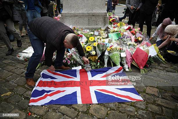 Farren Vanderhyden lays down a Union flag in Market Square in memory of Jo Cox Labour MP for Batley and Spen who was shot and stabbed yesterday by an...