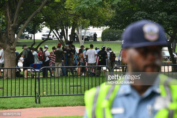 Farright demonstrators gather for a rally at Lafayette Park opposite the White House August 12 2018 in Washington DC one year after the deadly...