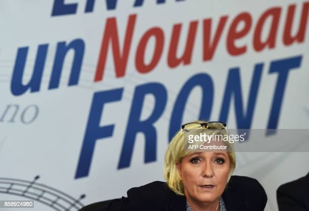 Farright Front National party leader Marine Le Pen answers to journalists at the FN Federation of Vaucluse during a press conference on October 08...