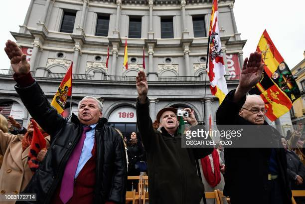Farright group Falange members perform the fascist salute during a demonstration marking the anniversary of the death of Spanish dictator Francisco...