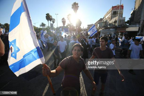 """Far-right Israelis holding Israeli flags stage """"flag march"""" starting from Ha-Nevi'im Street towards Damascus Gate in OId Town neighborhood of..."""