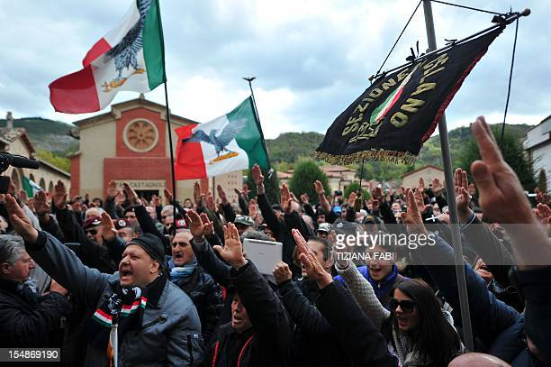 Farright militants make the fascist salute during a rally marking the 90th anniversary of the 'march on Rome' on October 28 2012 in Predappio The...