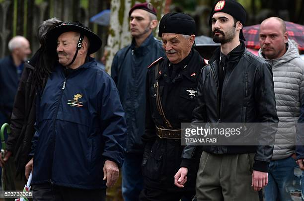 Farright militants march during a rally to celebrate the life and the death of Italian dictator Benito Mussolini in Predappio on April 24 2016 The...