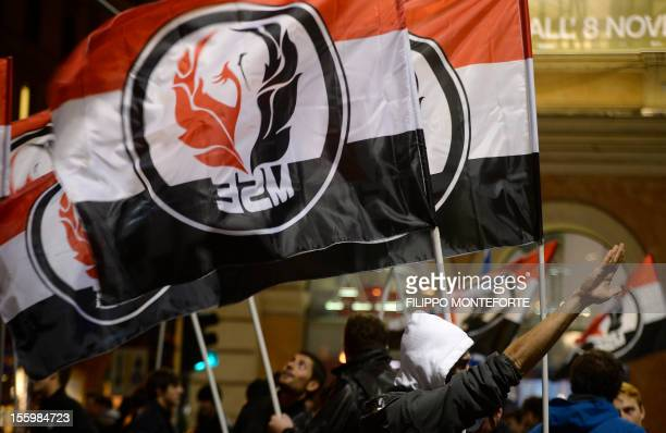 Far-right militants of the Movimento sociale europeo hold flags during a demonstration of far-right movements on November 10, 2012 in Rome. Some 200...