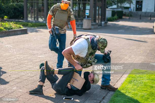 Far-right protester attacks a counter protester during a rally on September 7, 2020 in Salem, Oregon. A Pro-Trump caravan drove into the Oregon state...