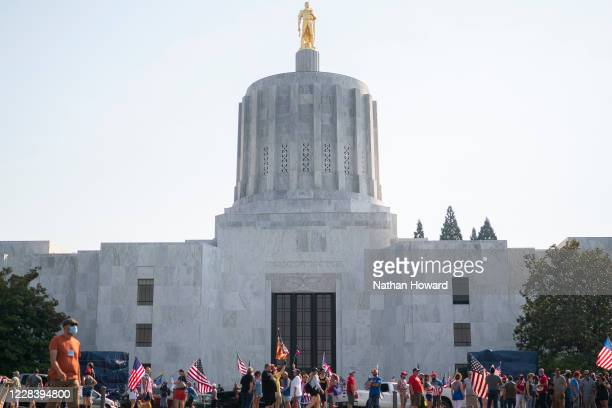Far-right protesters father in front of the state capitol during a rally on September 7, 2020 in Salem, Oregon. A Pro-Trump caravan drove into the...