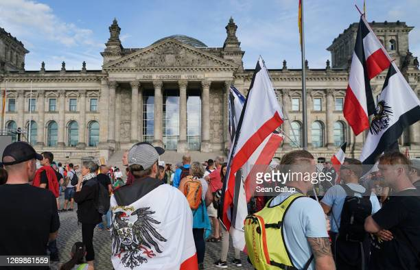Farright protesters gather outside the Reichstag during protests against coronavirusrelated restrictions and government policy on August 29 2020 in...