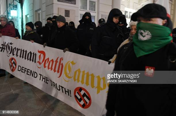 Farright protesters hold a banner during a demonstration to support a controversial new Polish bill regarding the Holocaust and the definition of...