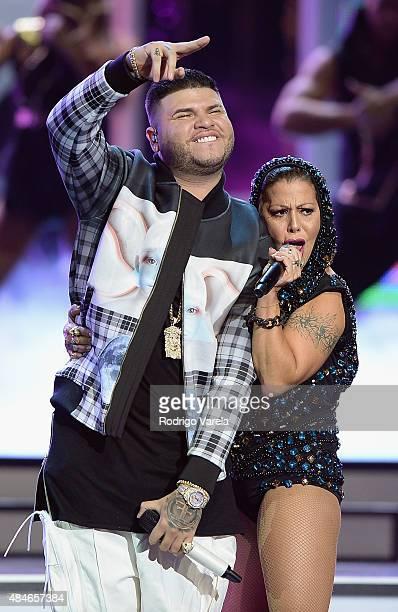 Farruko and Alejandra Guzman perform onstage at Telemundo's 'Premios Tu Mundo' Awards 2015 at American Airlines Arena on August 20 2015 in Miami...