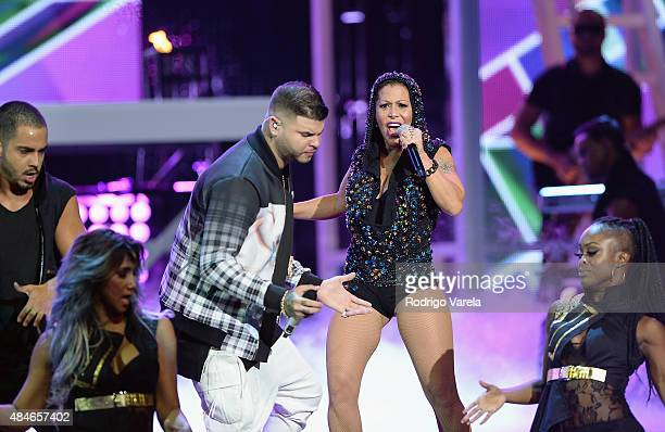 Farruko and Alejandra Guzman perform onstage at Telemundo's Premios Tu Mundo Awards 2015 at American Airlines Arena on August 20 2015 in Miami Florida