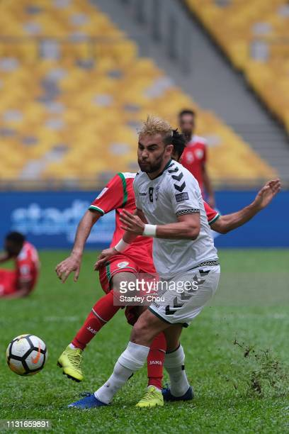 Farshad Noor of Afghanistan competes for the ball during the Airmarine Cup match between Oman and Afghanistan at Bukit Jalil National Stadium on...