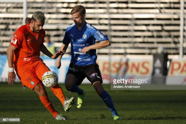 Farshad Noor of Athletic FC Eskilstuna and Tryggvi Hrafn Haraldsson of Halmstad BK compete for the ball during the Allsvenskan match between Halmstad...