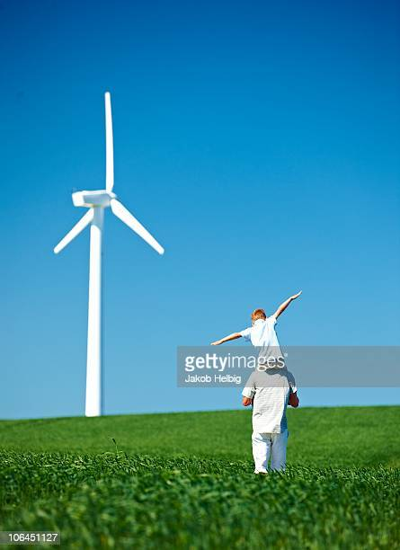 Farther and son, field, wind turbine