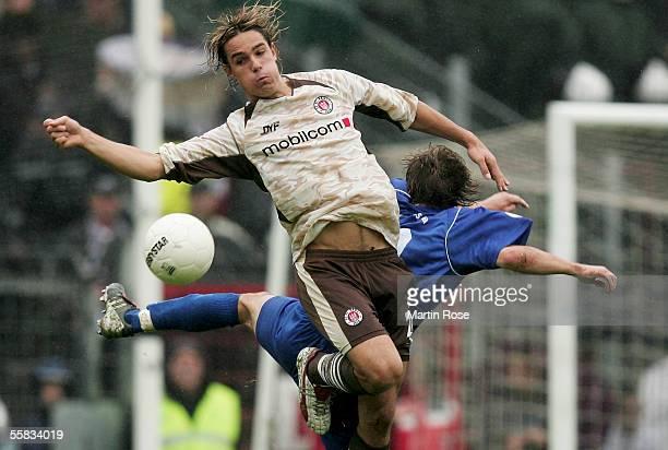 Faruk Hujduroviv of Jena tackles Felix Luz of StPauli during the match of the Third Bundesliga between FC St Pauli and Carl Zeiss Jena at the...