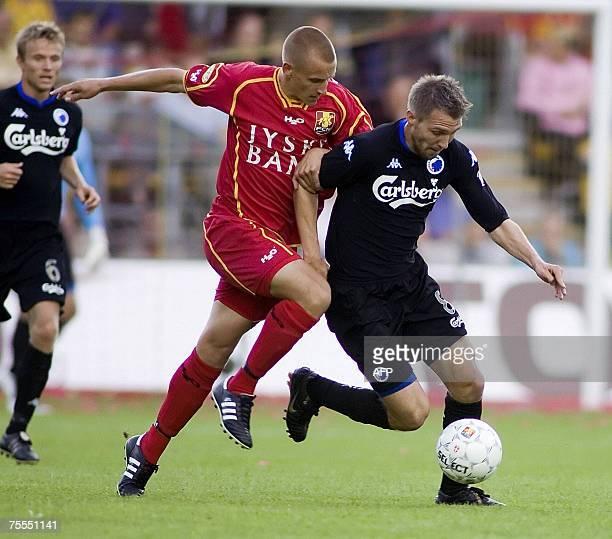 Michael Silbebauer of FC Copenhagen challenges FC Nordsjaelland's defender Kenni Olsen 18 July 2007 at Farum Park north of Copenhagen The Danish...