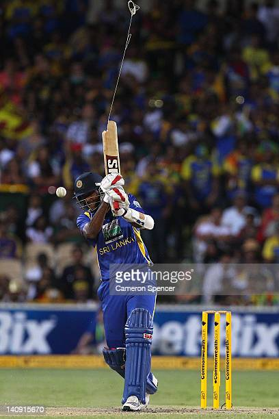 Farveez Maharoof of Sri Lanka breaks his bat as he plays a shot during the third One Day International Final series match between Australia and Sri...