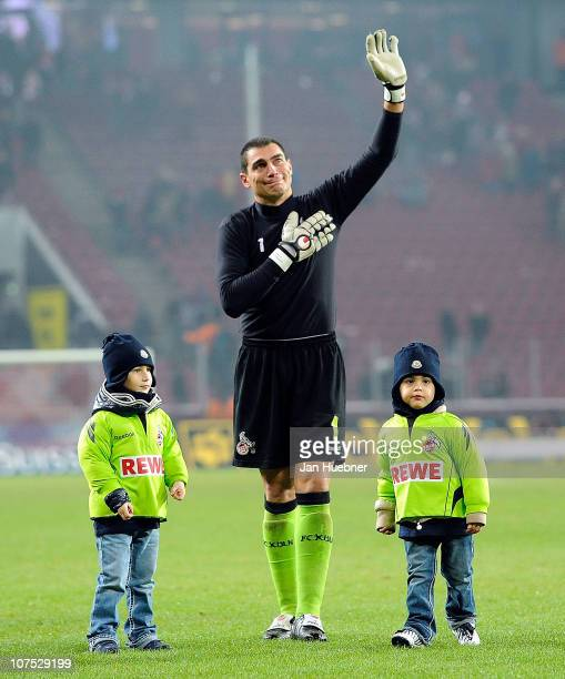 Faryd Mondragon of 1 FC Koeln and his kids wave to the fans after the Bundesliga match between 1FC Koeln and Eintracht Frankfurt at RheinEnergie...