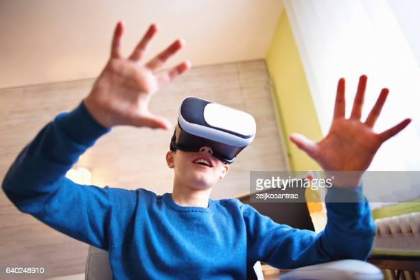Fascinated little boy using VR virtual reality