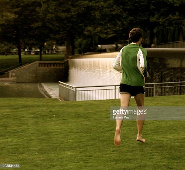 Fascinating subject. First of all I noticed he was barefoot running in the park on a cool night. Second he had on a green shirt and that photographs...