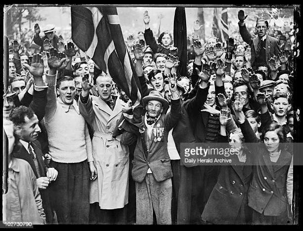Fascist demonstration, London, 1937. A photograph of a crowd of fascist supporters in Wood Street, Millbank, London, giving the Nazi salute for the...