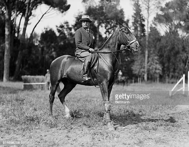 Fascist dictator Benito Mussolini rides a horse on the grounds of his villa in Rome.