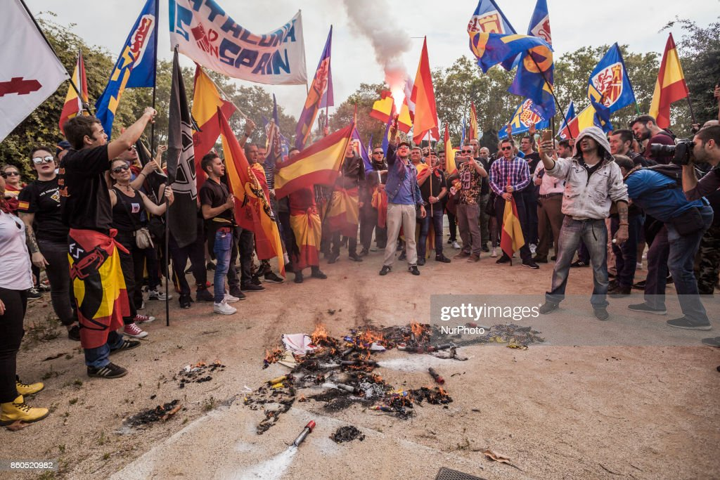 Fascist protesters burn Cataluña flags and hold flares during the celebrations of the Hispanic Day on October 12, 2017 in Barcelona, Spain.