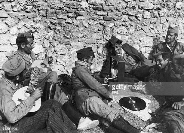 Fascist troops relax and listen to music towards the end of the Battle of Madrid during the Spanish Civil War 20th November 1936