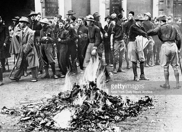 Fascists burn Communist and antiNationalist literature seized from a Socialist newspaper