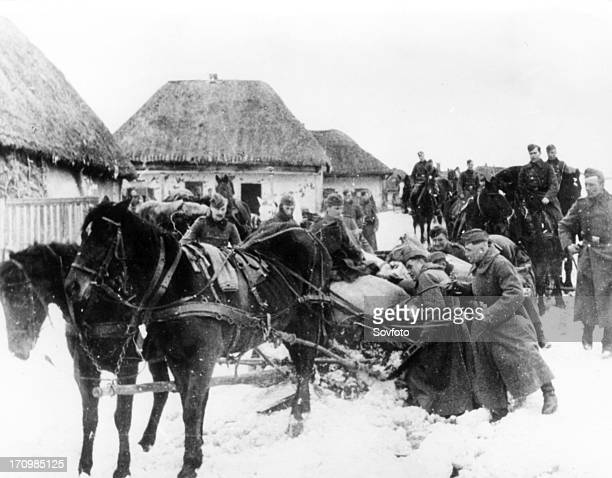 Fascists taking away food robbed of the local population in kharkhov region 1942