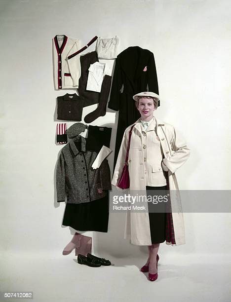 1956 Summer Olympics Preview Portrait of USA swimmer Carin Cone wearing Team USA parade uniform and worsted jersey coat during photo shoot Cone is...