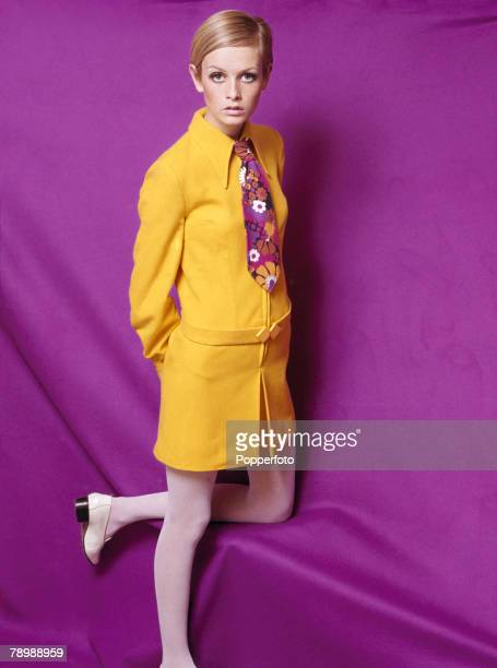 Fashion 1967 A portrait of the model Twiggy wearing a fashionable yellow collared outfit with a multicoloured floral tie posing for the camera in a...