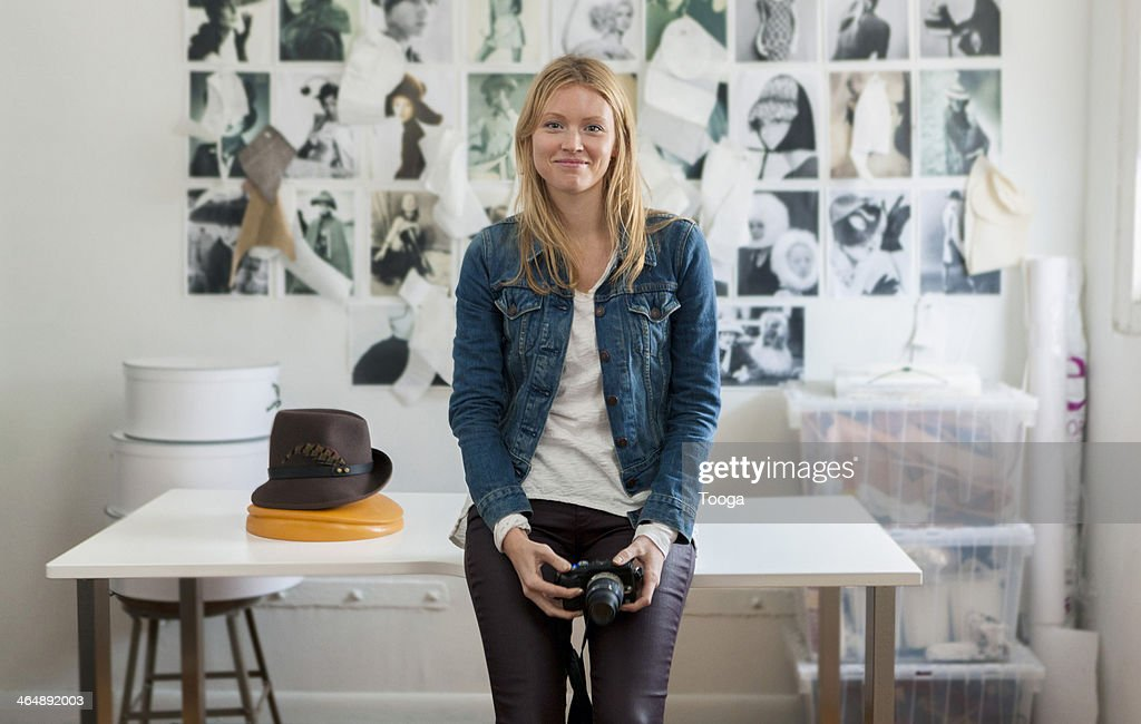 Fashion accessories designer holding camera : Stock Photo