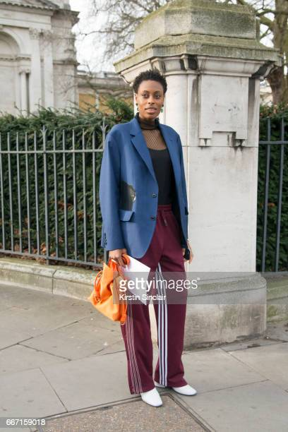 Fashion Accessories editor for Elle UK Donna Wallace wears Dorateymur boots Alexander Wang for Adidas trousers and Loewe bag on day 4 of London...