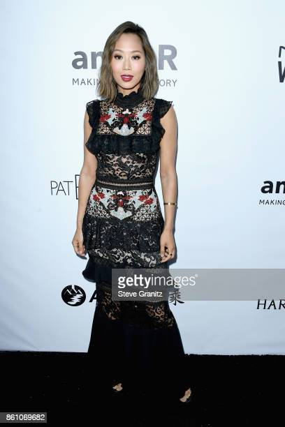 Fashion and interior design blogger Aimee Song attends the amfAR Gala 2017 at Ron Burkle's Green Acres Estate on October 13 2017 in Beverly Hills...