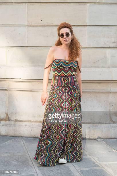Fashion and jewellery designer Natasha Zinko wears a Valentino dress and Natash Zinko earrings day 4 of Paris Haute Couture Fashion Week...