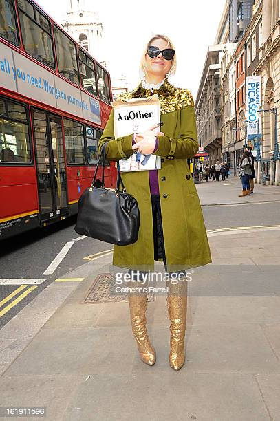 Fashion Assistant at Tatler London PhoebeLettice Thompson wears Burberry coat Zara trousers and Jimmy Choo gold mettalic boots with Smythson bag at...